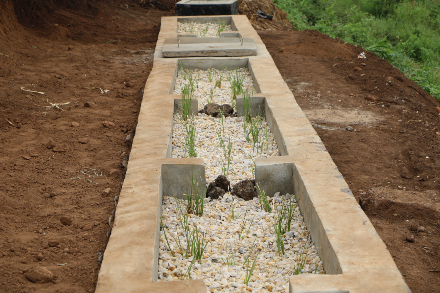 A tri-dimensional waster water at Nyarugenge Prison treats, recycles and re-uses the waste water generated from the prison, helping to protect the surrounding environment. The resulting effluent is used for irrigation of the Community Sanitation Garden (CSG) to improve agricultural productivity of the prison in dry and rainy seasons. (credits: LVEMP II Rwanda / Flickr Creative Commons Attribution 2.0 Generic (CC BY 2.0))